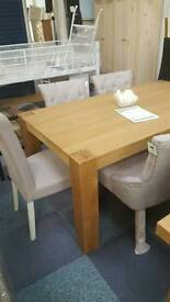 Brand new oak dining table and 6 chairs
