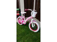 """Girls 14 """" Hello kitty bike with basket on front like new can deliver for a small charge"""