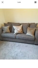 2/3 seat tweedy/neutral sofa with Harlequin scatter cushions