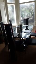 Glass dining table with six chairs ...very heavy and well made ...good used condition