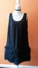 Black dress with faux-ostrich feather hem and embellished neckline - size 12 (worn once-cost £79)