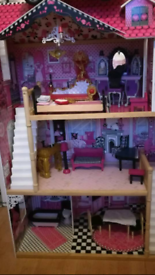 Beautiful dolls house in immaculate condition, furniture included