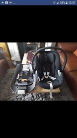 Black mamas and papas car seat and isofix base
