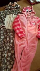 Two never worn 8 / 9 onesie