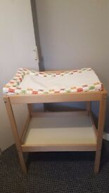 Changing table with brand new mat