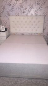 Double divan bed, light grey.