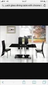 Glass and chrome dinning table
