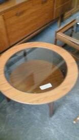 Round wooden and glass coffee table