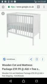 White cot and mattress