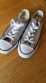 Silver converse shoe worn one