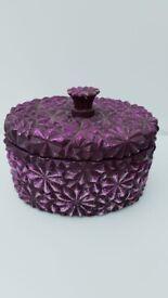 Purple wooden decorative pot.