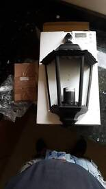 Black half wall light. Lighting