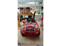 Kids Red battery powered mini cooper