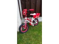 "Girls 12.5 "" bike minnie mouse with dolly seat can deliver for a small charge"