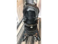 Gray silver cross pushchair with baby changing bag plus Buggy Bored.