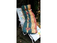 Reclining white plastic garden chair with two covers