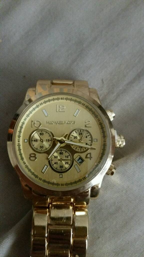 Mens or ladys gold micheal kors watch