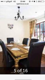 Oak table with 6 leather chairs