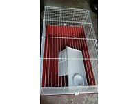 Indoor pet cage suitable for rabbits and guinea pigs.