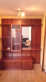 Rosewood veneer chest of drawers, cupboard and wall panels
