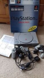Comes with box and instructions. A Playstation1 console with free demos. Plays audio cds too !