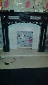 Black wood fire surround with marble harth