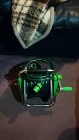 Brand new hose & reel