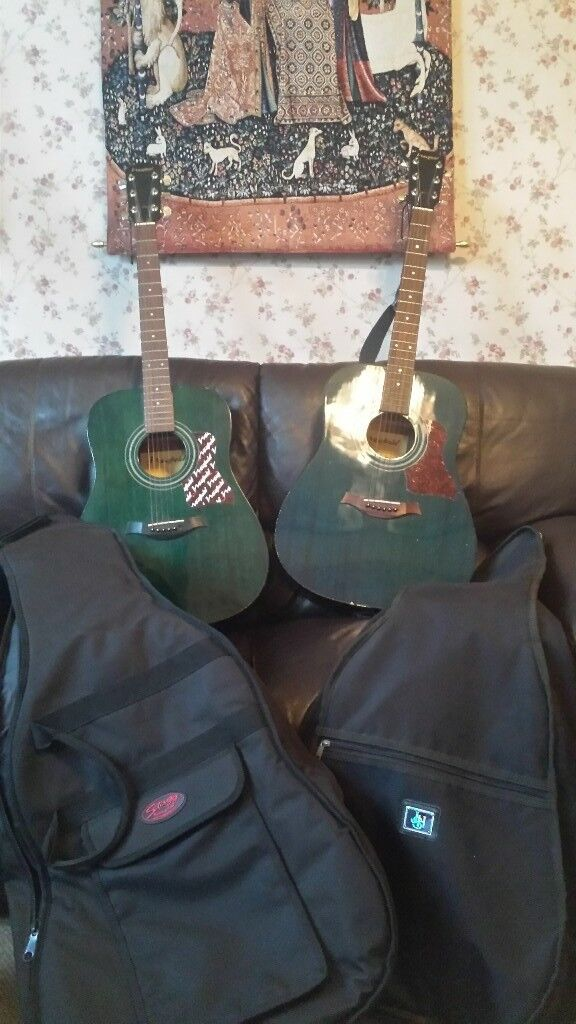 2 Acoustics Guitars with cases