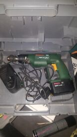 Bosch drill 9.6 volt. cordless with charger. With carry case hardley used for home diy.