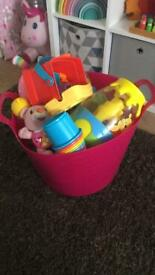 Large toy bundle with plastic basket