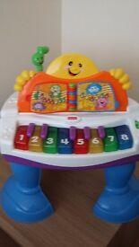 Baby piano table