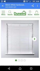 White wooden venitian blinds