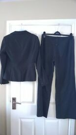 Next lady's trouser suit. Size 10 top, size 12 trousers. Grey pinstripe. Excellent condition.