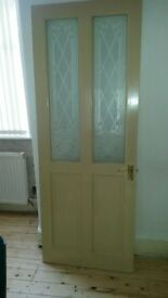 Victorian wooden interior door with glass panels