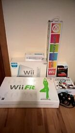 Nintendo Wi , games , fit and extras in as new condition.