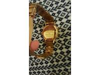 Nixon rose gold ladies watch