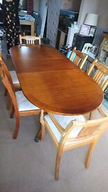 Beautiful solid wood antique looking table and chairs