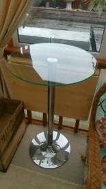 Tall glass/stainless retro style table..