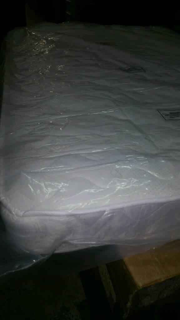 A brand new still packed mem foam topped double mattress.