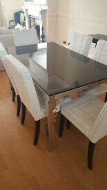 Italian glass dining table with 6 white suede chairs