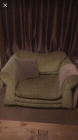 Large green sofa and two chairs.