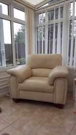Cream leather two seater sofa and arm chair