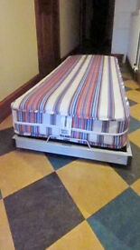 Pull-out Guest bed and Brand New mattress. FREE for Uplift