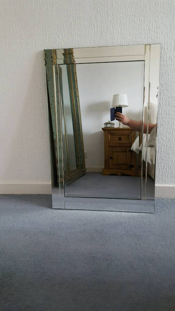 Large frameless mirror.