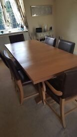 Beautiful oak table and six leather and oak chairs