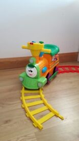 Ride on toy train and track