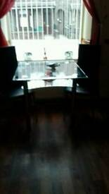 2 tier glass table and leather chairs