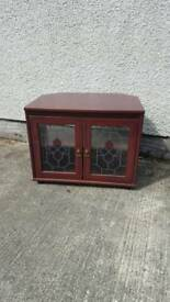Mahogany coloured tv cabinet with stained glass style front, books or storage unit