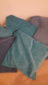 Bundle of blue cushions and beanbag. 7 items.
