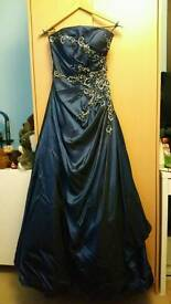 Beautiful blue prom dress with sliver clutch bag